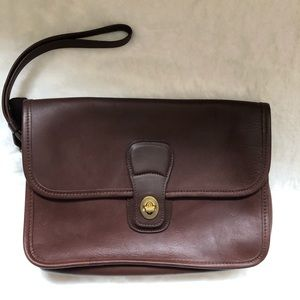 Coach leather clutch mahogany brown.